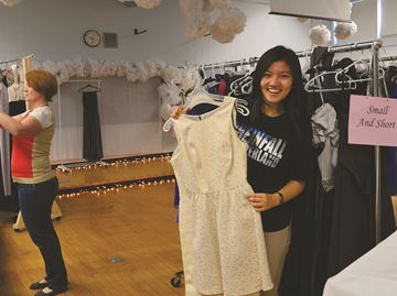 Diana Zhang checks out a dress at the Pop Up Prom Shop at Bell High School.